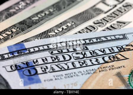 Dollar bills of different value on the table closeup. Shallow depth of field - Stock Photo