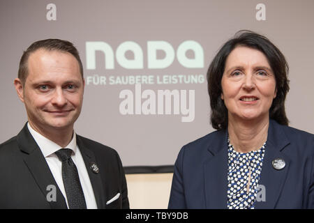 Berlin, Germany. 04th June, 2019. Lars Mortsiefer, Member of the Executive Board of the German National Anti-Doping Agency (NADA), and Andrea Gotzmann, NADA CEO, at the NADA Annual Press Conference. Credit: Jörg Carstensen/dpa/Alamy Live News - Stock Photo