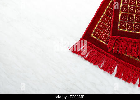 Muslim prayer rug on white background - Stock Photo