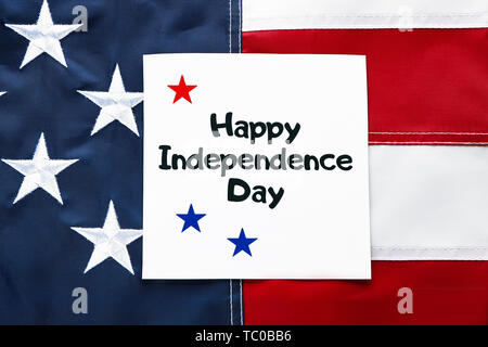 Card with text HAPPY INDEPENDENCE DAY on the USA flag - Stock Photo
