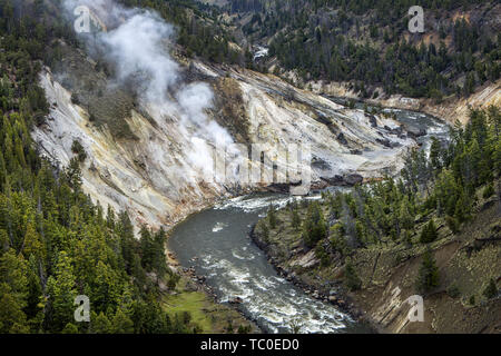 The scenic overlook of Calcite Springs looking over at the Yellowstone RIver. - Stock Photo