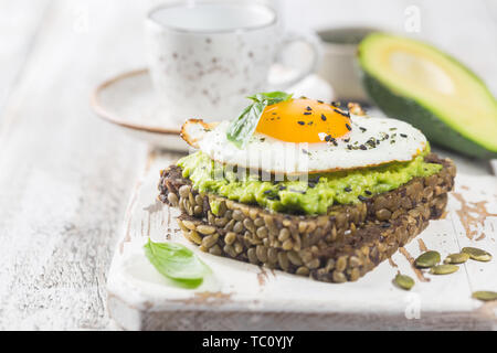 Sandwich with avocado and egg - Stock Photo