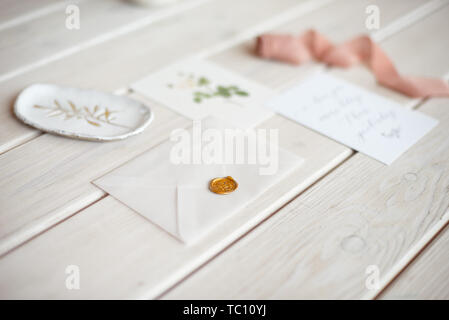 Feminine wedding desktop mock-up with blank paper card and Eucalyptus populus branch on white shabby table background. Empty space. Styled stock photo - Stock Photo