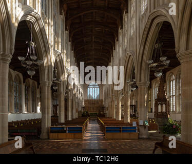Interior of Holy Trinity Church, Long Melford, Suffolk, England, UK view down nave to east window - Stock Photo
