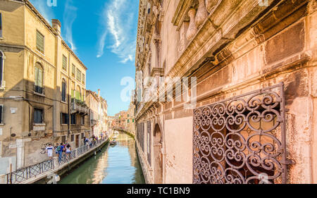 VENEZIA, ITALY – MAY 31, 2019: tourists visiting the city and enjoying the view of waters flowing in Rio Marin,  water channel of Venice along Fondame - Stock Photo