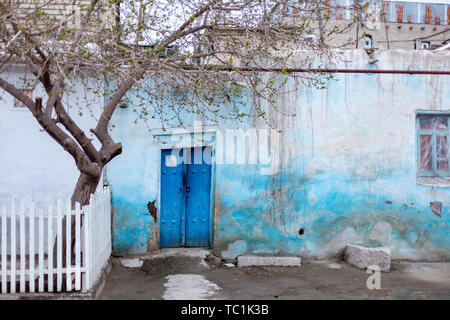 entrance to the tomb and open door in Shah-I-Zinda, a memorial complex, necropolis in Samarkand, Uzbekistan. - Stock Photo