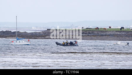 Naval crew from LE James Joyce provide security in Doonbeg Bay in west County Clare, Ireland, as the village prepares for the arrival of US President Donald Trump. - Stock Photo