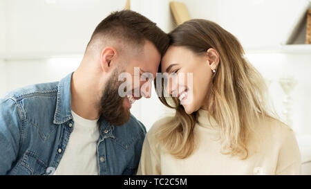 Loving Couple Enjoy Tender Moment Touching Foreheads - Stock Photo