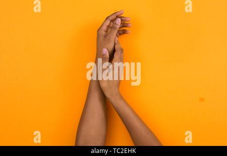 African american woman hands applying moisturizing cream - Stock Photo