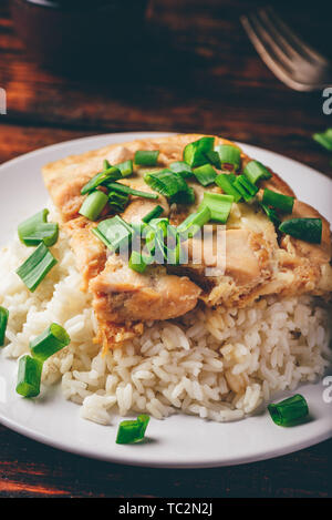 White rice with scrambled eggs with chicken and green onion on plate - Stock Photo