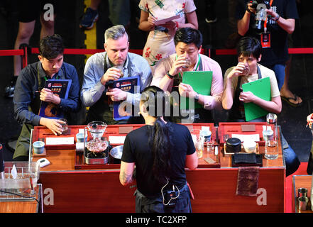 Chengmai, China's Hainan Province. 4th June, 2019. Judges taste coffee made by contestants during the 8th China Fushan Cup International Barista Championship in Chengmai County, south China's Hainan Province, June 4, 2019. Twenty-three baristas from countries and regions including China, Germany, Mexico, Australia and Singapore took part in the competitions. Credit: Guo Cheng/Xinhua/Alamy Live News - Stock Photo