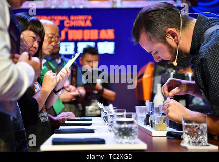 Chengmai, China's Hainan Province. 4th June, 2019. Australian barista Joao Carlos Henriques makes coffee during the 8th China Fushan Cup International Barista Championship in Chengmai County, south China's Hainan Province, June 4, 2019. Twenty-three baristas from countries and regions including China, Germany, Mexico, Australia and Singapore took part in the competitions. Credit: Guo Cheng/Xinhua/Alamy Live News - Stock Photo