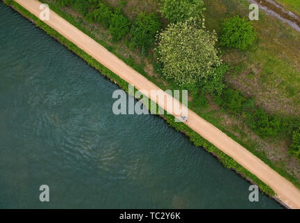 Beijing, China. 10th May, 2019. Aerial photo taken on May 10, 2019 shows a citizen riding beside the Emscher River in Essen, Germany. Credit: Lu Yang/Xinhua/Alamy Live News - Stock Photo