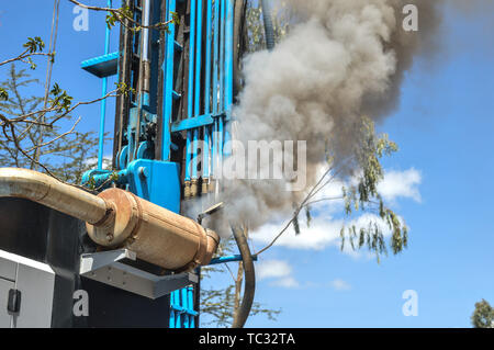 Nakuru, Rift Valley, Kenya. 17th May, 2019. A water drilling rig emits plumes of smoke at an area with high water scarcity in Naivasha, Nakuru. Smoke from vehicles has been blamed for the increasing air pollution which is also a cause of climate change. Poor air quality increases respiratory diseases putting the lives of millions of people under imminent threat from diseases like asthma, bronchitis and cancers. This year's World Environment Day theme is ''Beat Air Pollution' Credit: James Wakibia/SOPA Images/ZUMA Wire/Alamy Live News - Stock Photo