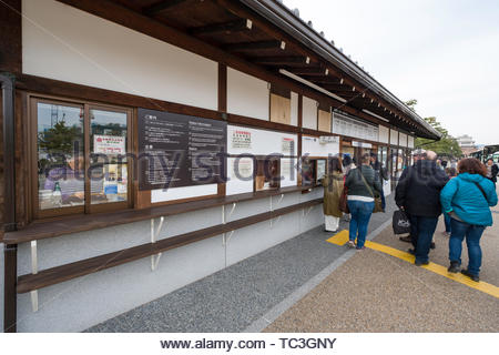 People standing in line to purchase tickets to enter Nijo Castle, Nijojocho, Nakagyo-ku, Kyoto, Honshu, Japan - Stock Photo