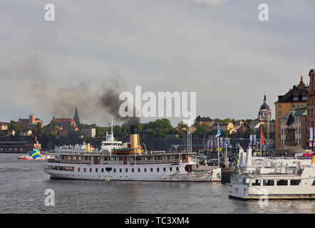 Coal-fueled steam boat Blidösund prepares for a a cruise in Stockholm, Sweden - Stock Photo