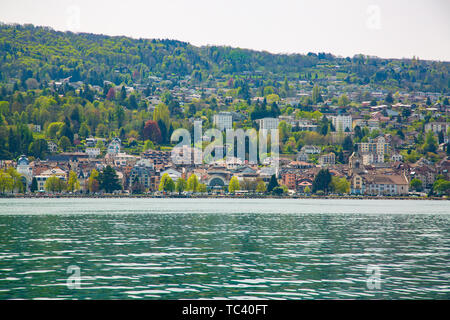 View of Evian-les-Bains city taken from Lake Geneva in France - Stock Photo