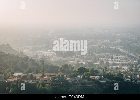 Hazy view of the San Fernando Valley from Mulholland Drive, in Los Angeles, California - Stock Photo