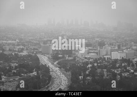 Black & white hazy cityscape view from the Hollywood Bowl Overlook on Mulholland Drive, in Los Angeles, California - Stock Photo