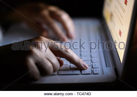 File photo dated 06/08/13 of a woman using a laptop. The UK is more vulnerable than ever before to cyber attacks, a Commons report has warned. - Stock Photo