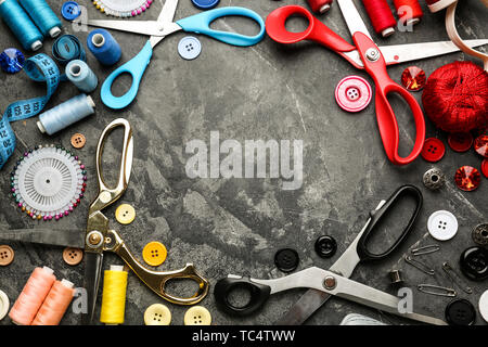 Frame made of sewing threads and accessories on grunge background