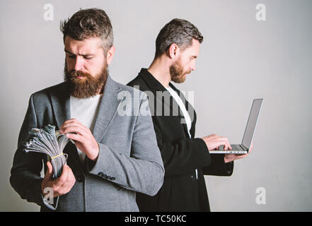 Team of web developer with laptop and sales manager with cash money. Developing applications. Digital technology. IT business. Online business. Earn money online business. They know how to make money. - Stock Photo