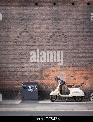 A moped on the streets of Copenhagen in Denmark. - Stock Photo
