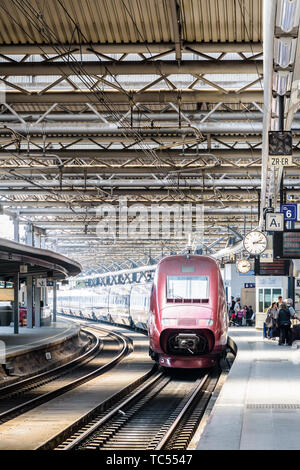 A Thalys high-speed train is stationing at a platform for boarding in Brussels-South railway station, the busiest SNCB railway station in Belgium. - Stock Photo