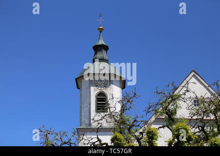 Church steeple on the background of clear sky. - Stock Photo
