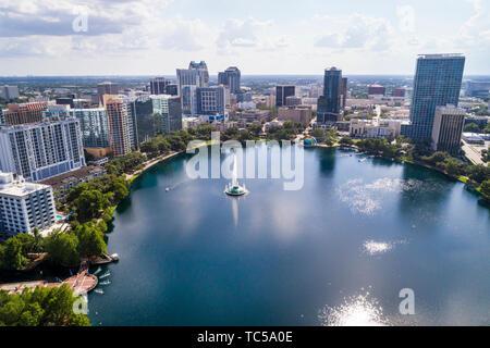 Orlando Florida Lake Eola Park downtown city skyline high rise office buildings residential condominium apartment aerial overhead bird's eye view abov - Stock Photo