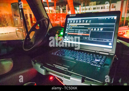 Miami Beach Florida North Beach Fire Rescue ambulance inside laptop computer screen medical emergency event possible heart attack details night - Stock Photo