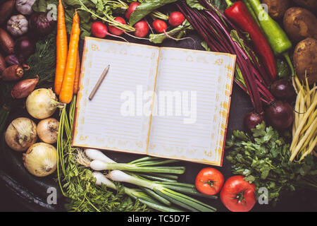 Blank Recipe Empty Cook Book Mockup with Fresh Vegetables. Vegan Raw Food. Healthy Eating Concept with Copy Space. - Stock Photo