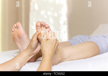 Woman having feet massage in spa salon. - Stock Photo