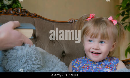 Portrait of funny little girl at home - Stock Photo