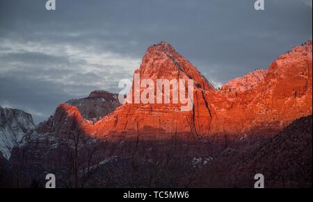 The light from the setting sun shines on Zion Canyon during winter at Zion National Park, Utah. - Stock Photo