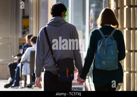 young couple walking hand in hand, street life, old town of Bayreuth, Maximilianstrasse - main touristic promenade in old town, Bayreuth, capital of - Stock Photo