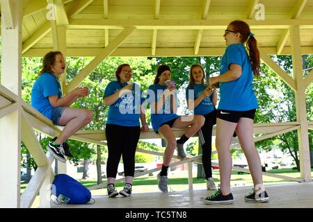 6th Grade Girls Hanging Out During School Outing, Wellsville, New York, USA. - Stock Photo