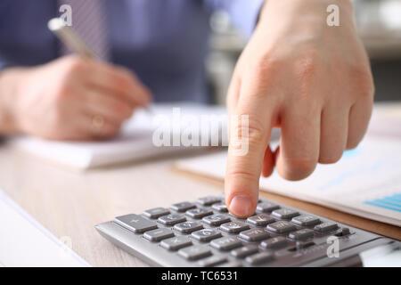 Businessman Calculate Finance Budget Press Button - Stock Photo