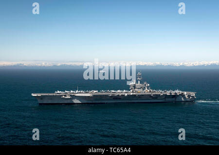 The U.S. Navy Nimitz-class nuclear powered aircraft carrier USS Theodore Roosevelt during exercise Northern Edge 2019 May 24, 2019 in the Gulf of Alaska. - Stock Photo