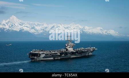 The U.S. Navy Nimitz-class nuclear powered aircraft carrier USS Theodore Roosevelt during exercise Northern Edge 2019 May 25, 2019 in the Gulf of Alaska. - Stock Photo