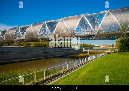Bridge by Perrault and river Manzanares. Madrid Rio park, Madrid, Spain. - Stock Photo