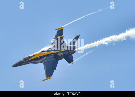 190602-N-UK306-2231 OKLAHOMA CITY, Okla. (June 2, 2019) Capt. Eric Doyle, flight leader and commanding officer assigned to the The U.S. Navy Flight Demonstration Squadron, the Blue Angels, performs during a demonstration at the Star Spangled Salute Air and Space Show at Tinker Air Force Base in Oklahoma City. The team is scheduled to conduct 61 flight demonstrations at 32 locations across the country to showcase the pride and professionalism of the U.S. Navy and Marine Corps to the American and Canadian public in 2019. (U.S. Navy photo by Mass Communication Specialist 2nd Class Timothy Schumak - Stock Photo