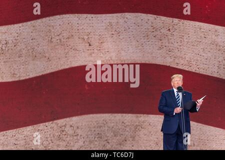 Portsmouth, UK. 05th June, 2019. U.S President Donald Trump addresses an event to marking the 75th anniversary of D-Day June 5, 2019 in Portsmouth, England. World leaders gathered on the south coast of England where troops departed for the D-Day assault 75-years-ago. Credit: Planetpix/Alamy Live News - Stock Photo