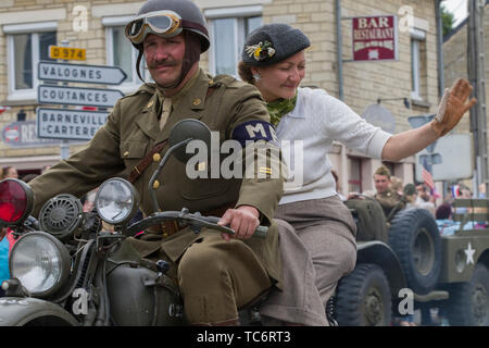 Carentan, France. 05th June, 2019. Residents of Normandy dressed in period costume take part in a parade to commemorate the 75th anniversary of the World War Two D-Day invasion June 5, 2019 in Carentan, Normandy, France. Thousands have converged on Normandy to commemorate the 75th anniversary of Operation Overlord, the WWII Allied invasion commonly known as D-Day. Credit: Planetpix/Alamy Live News - Stock Photo