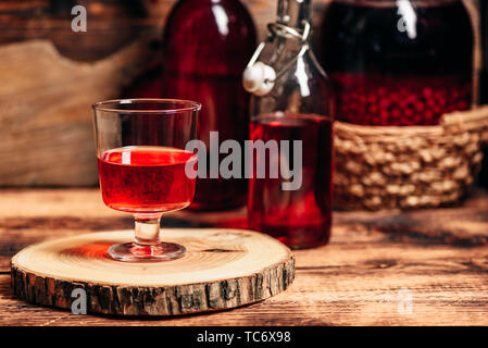 Homemade red currant liquor in wine glass - Stock Photo