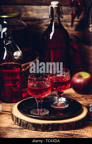 Two glasses of red homemade wine on tray - Stock Photo