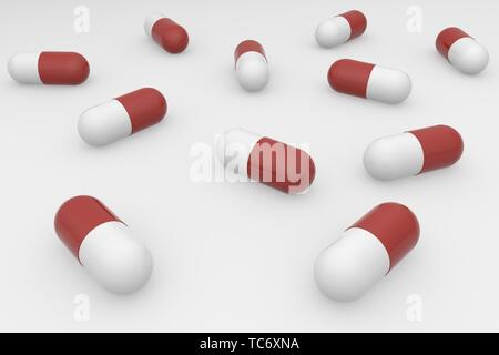 A group of red white pills on a white background. Antibiotics in the capsule. 3d rendering - Stock Photo