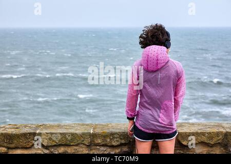 Woman doing sport looking at the sea, Paseo Nuevo, Donostia, San Sebastian, Gipuzkoa, Basque Country, Spain - Stock Photo