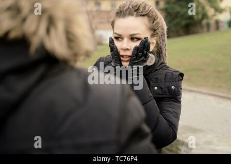 worried woman looking away, in park, in Cottbus, Brandenburg, Germany - Stock Photo