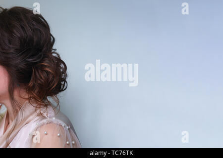 Long hair in hairstyle, ombre, styling in beauty salon. Side view. Wedding and prom ball hairstyles. Beauty industry - Stock Photo